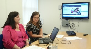 During a webinar session staff refer to laptop screen whilst answering questions.